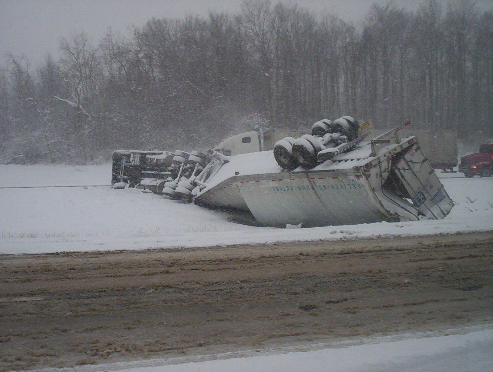 Overturned loaded with shovels